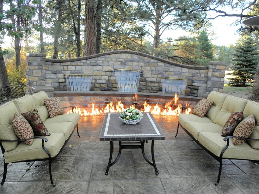 Privacy Wall With Three Colorfalls And Firepit On Patio Create An Inviting  Outdoor Space